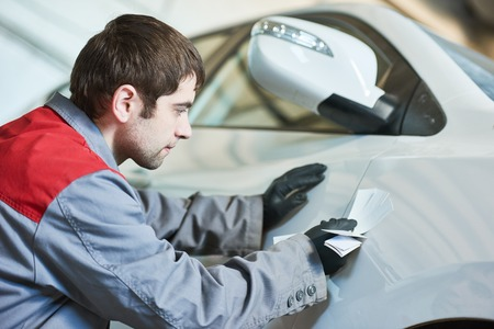 colourist man selecting color of car with paint matching samples Stock Photo