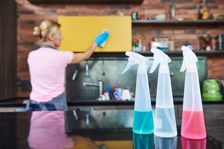 charlady: Cleaning service. woman clean kitchen Stock Photo