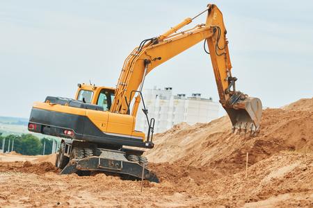 wheel excavator at sandpit during earthmoving works Stock Photo
