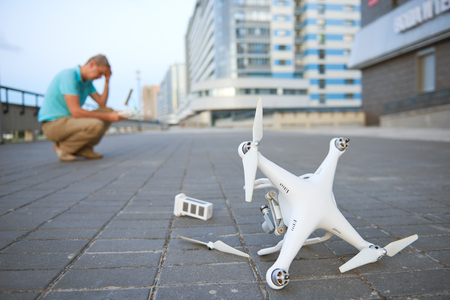 Drone crash. Fallen damaged quadrocopter in city Stock Photo
