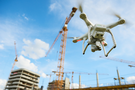 Drone over construction site. video surveillance or industrial inspection Banco de Imagens