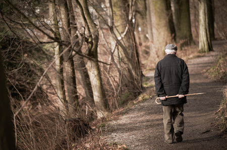 Elderly man going away in park. Toned Stock Photo - 83893510
