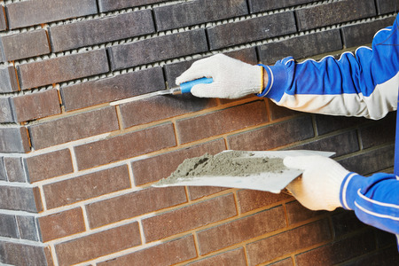 bricklaying 벽돌 접합기 흙손을 사용하여