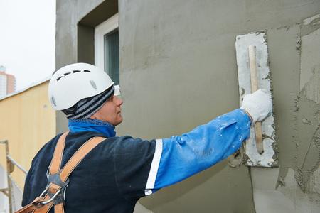 master: worker at plastering facade work