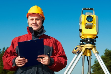 road position: surveyor worker with theodolite Stock Photo