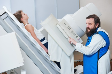 Radiology specialist at work. male radiologist in protective wear Stock Photo