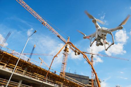 Drone over construction site. video surveillance or industrial inspection Standard-Bild