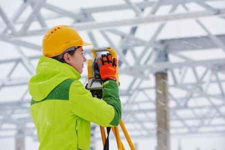 exact position: surveyor works with theodolite Stock Photo