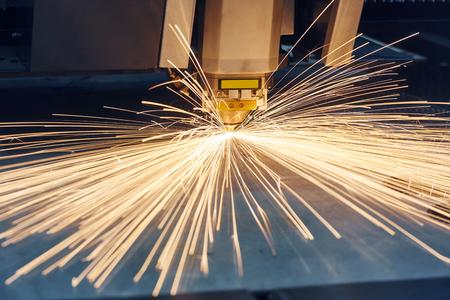 sheet: Laser or plasma cutting technology of flat sheet metal. Stock Photo