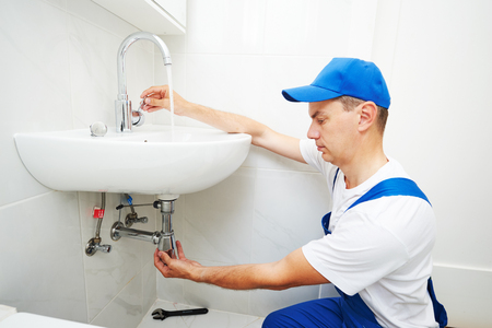 plumber man repair leaky faucet tap Stock Photo - 83807819