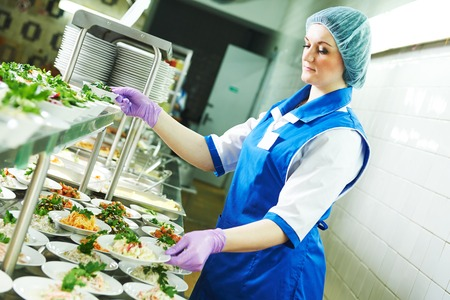 buffet female worker servicing food in cafeteria Reklamní fotografie - 84013943