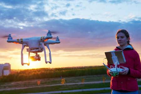drone flying at sunset Stock Photo