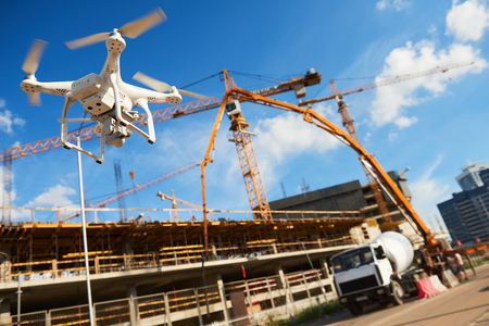 Drone over construction site. video surveillance or industrial inspection Banque d'images