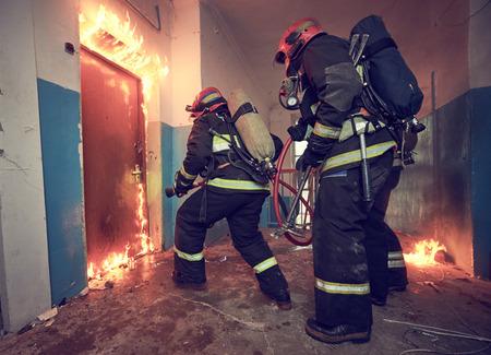 Firemans team during firefighting Stock Photo