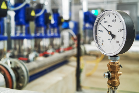 manometer pipes and valve in water pump station Standard-Bild