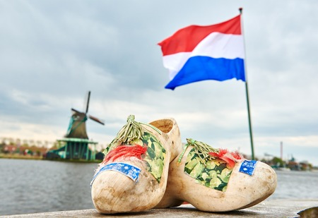 holland. Wooden shoes netherland flag and windmill in zaanse schans