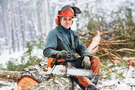 Lumberjack portrait tree in snow winter forest Stock Photo