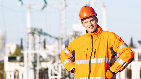 supervisión: Service engineer standing near heat electropower station