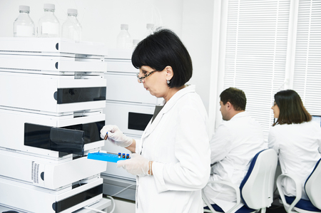 chromatography. Researcher putting flask in equipment Stock Photo