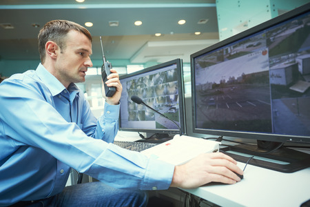 Security worker during monitoring. Video surveillance system. Stock Photo - 90341869