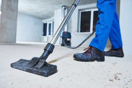 Cleaning service. dust removal with vacuum cleaner Standard-Bild