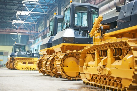 bulldozer in assembly shop in factory