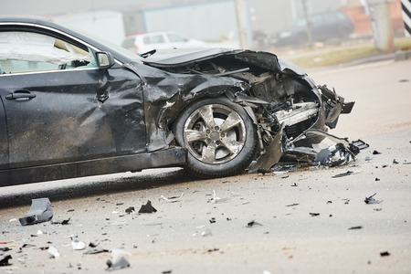 car crash accident on street, damaged automobile after collision in city Stock Photo