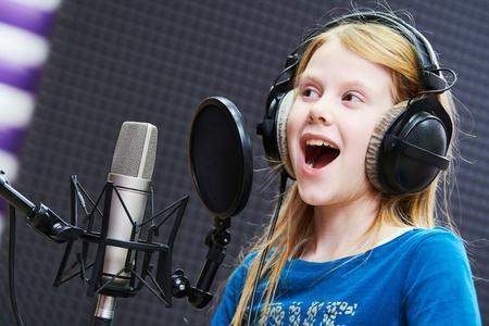 Regording studio. Child girl singing or role voicing