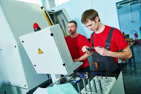 worker at tool workshop Standard-Bild
