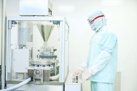 Worker operating pharma capsule filling machine