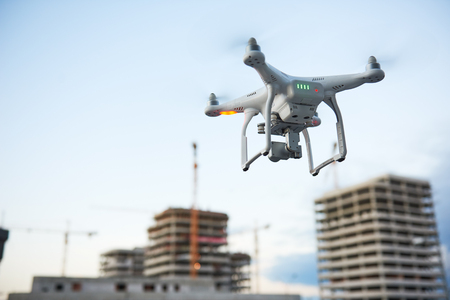 Drone over construction site. video surveillance or industrial inspection Stock Photo