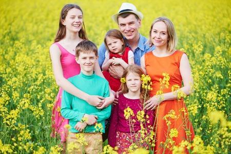 Big family in summer field outdoors. Standard-Bild