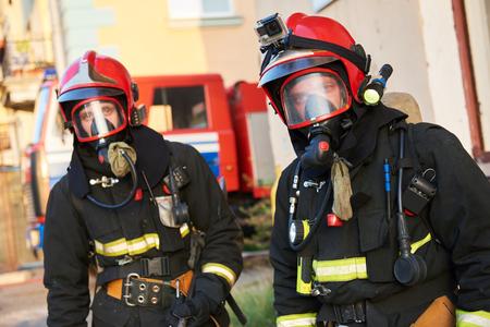 Firemans team during firefighting Standard-Bild