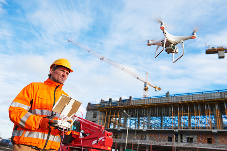 Drone operated by construction worker on building site Zdjęcie Seryjne - 97213207