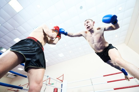 Muay thai fighters at boxing ring Stock Photo