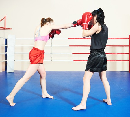 Muay thai woman fighting at training ring Stock Photo