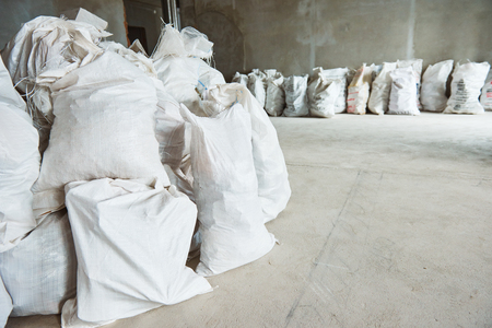 Cleaning debris. Heap of construction waste in bugs in apartment