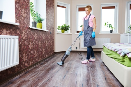 Hotel Cleaning Service. Female Housekeeping Worker With Vacuum ...