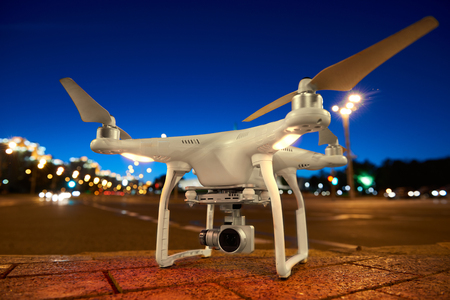 Drone ready to fly standing on urban street Stock Photo