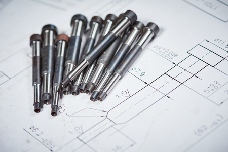 Engineering and metalworking industry. Metal details on print drawing