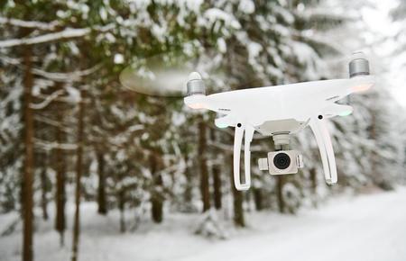 drone hovering in winter forest Reklamní fotografie
