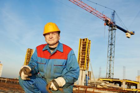 Builder making reinforcement for concrete