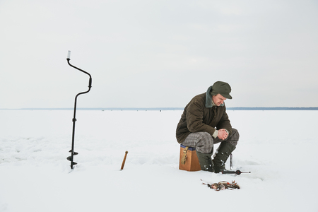 fishing at winter. Fisherman waiting fish bite