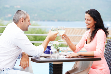 young man and woman celebrating in restaurant Stock Photo