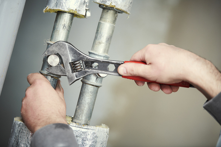 Plumber work. hand with wrench