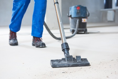 building cleaning service. dust removal with vacuum cleaner Stock Photo