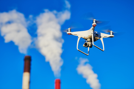 security and safety. drone flying near power plant. Stock Photo