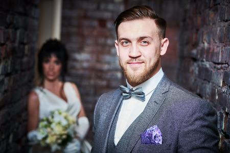 wedding. bridegroom or fiance portrait with bride on background Stock Photo