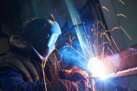 Welder worker at industrial arc welding work Stock Photo