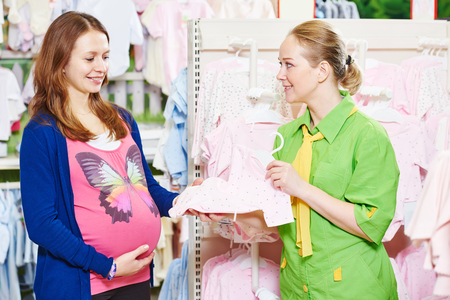 Pregnant shopping. young woman shopping during pregnancy